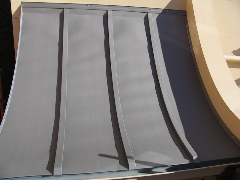 Zinc roofing Sydney-Traditional curved batten roll.Zinc roofing